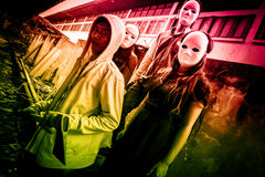 Strangers. Group of young people in halloween concept and book cover ideas Stock Photos