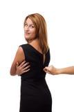 Strangers hand unzipping dress. Stranger's hand unzipping dress. Studio shot Royalty Free Stock Images