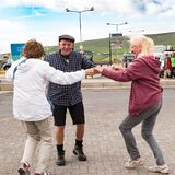 Seniors spontaneous dancing to typical irish street music in the street of Dingle, Ireland