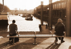 Strangers. Two Strangers Waiting for Ferry, Bristol, England (Sepia Royalty Free Stock Photography