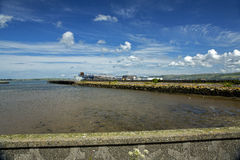 Stranraer harbour and railway station. Stranraer railway station is at the end of the harbour jetty. The harbour has been disused since ferry services moved to Royalty Free Stock Photos