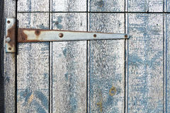 Strap hinge on old wooden stable door. Stock Photos