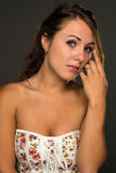 Strapless top. Portrait of a beautiful young brunette in a strapless top Royalty Free Stock Image