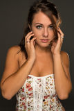 Strapless top. Portrait of a beautiful young brunette in a strapless top Royalty Free Stock Photo