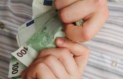Strappo su dei soldi Fotografia Stock Libera da Diritti