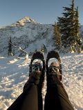 Strapped on snowshoes Stock Images