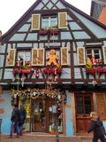 Small cities decorated for Christmas Strasbourg - Alsace, France. Strasbourg, Alsace, France - December 27, 2017: facades of houses decorated for Christmas in Royalty Free Stock Photo