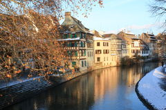 Strasbourg canal in winter. One of the Strasbourg's canal, seen on the sunset in winter, with the houses illuminated by the last beams of sun Royalty Free Stock Photo