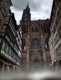 Strasbourg cathedral. Cathedral of Notre-Dame of Strasbourg and houses near it Stock Photos