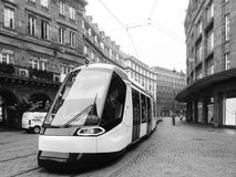 Strasbourg central city center with new tramway design. STRASBOURG, FRANCE - SEP 25, 2017: Tramway through empty Strasbourg downtown on an autumn morning - black Stock Photo