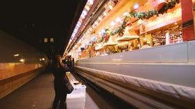 Strasbourg Christmas Market stall preparation woman taking photo. Strasbourg, France - circa 2018:Woman taking photo on phone at Christmas market stalls stock video