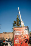 Strasbourg Christmas Tree Erected. Strasbourg, France - November 5, 2013: Installation of a giant Christmas tree by cranes on the Place Kleber in Strasbourg's Stock Image