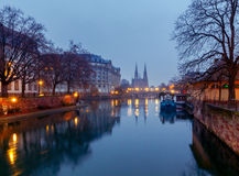 Strasbourg. The Church of the Reformation. Picturesque views of the Reformation church with mirror images in Ile river at dawn. Strasbourg, Alsace, France Royalty Free Stock Photos