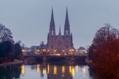 Strasbourg. The Church of the Reformation. Picturesque views of the Reformation church with mirror images in Ile river at dawn. Strasbourg, Alsace, France Royalty Free Stock Image