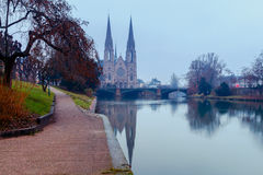Strasbourg. The Church of the Reformation. Picturesque views of the Reformation church with mirror images in Ile river at dawn. Strasbourg, Alsace, France Royalty Free Stock Images