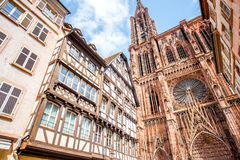 Strasbourg city in France. Street view from below on the beautiful old buildings and Notre-Dame cathedral in Strasbourg city, France Royalty Free Stock Photography