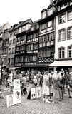 Strasbourg downtown with people and painters Royalty Free Stock Images