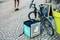 Eliveroo bike and isothermic food delivery cargo box parked