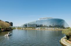 European Parliament facade building with Police Gendarmerie boat Royalty Free Stock Photos