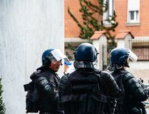 Squadron of police gerdarms officers secruing street in Strasbourg. Strasbourg, France - Apr 28, 2019: Squadron of police gerdarms officers secruing entrance to stock photos