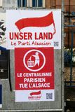 Unser Land Le Parti Alsaciene poster in Strasbourg. STRASBOURG, FRANCE - APR 23, 2017: Unsern Land - Le Centralisme Prisien tue l'Alsace translated as Parisian Stock Photo