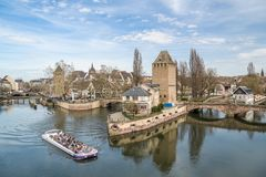 Cruise ship on water canal near Little France district in Strasb. STRASBOURG, FRANCE - APRIL 03, 2018: Cruise ship on water canal near Little France district in Royalty Free Stock Photos