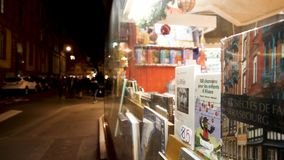 Dinali bookshop bookstore in central Strasbourg time-lapse fast motion. STRASBOURG, FRANCE - CIRCA 2018: Focus on the book from the Dinali bookstore in central stock footage