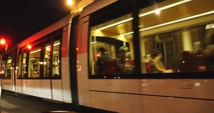Tramway in Strasbourg. Strasbourg, France - Circa 2017: French CTS tramway car with passengers motion at night near Opera du Strasbourg building stock video footage