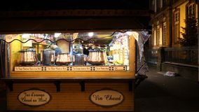 Christmas Market installation before inauguration mulled wine market stall. STRASBOURG, FRANCE - CIRCA 2018: Owners arranging bowls with mulled wine inside stock video footage