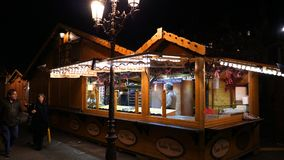 Christmas Market installation before inauguration selling food and mulled wine. STRASBOURG, FRANCE - CIRCA 2018: Senior man arranging the Christmas market stalls stock video footage