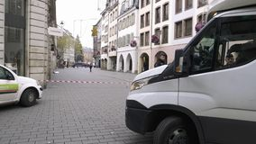 Police surveilling terrorist attack scene after attack Strasbourg. Strasbourg, France - Dec 11, 2018: Delivery van in front of French Police officers securing stock video footage