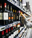 Woman buying shopping for wine in supermarket France stock photos