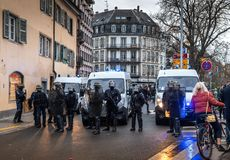 Police officers securing the zone in front of Yellow Jackets Gil. STRASBOURG, FRANCE - DEC 8, 2018: Front view of police officers securing the zone in frong of royalty free stock images