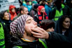 Whistling at Marche Pour Le Climat march protest on French stree. STRASBOURG, FRANCE - DEC 8, 2018: Man whistling next to crowd marching in Central Strasbourg at royalty free stock photography