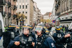 Police officers securing the zone in front of Yellow Jackets Gil. STRASBOURG, FRANCE - DEC 8, 2018: Police officers in front of the Yellow vests movement royalty free stock photo