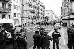 Police officers securing the zone in front of Yellow Jackets Gil. STRASBOURG, FRANCE - DEC 8, 2018: Police officers securing the zone in front of the Yellow stock image