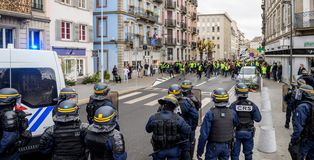 Police officers securing the zone in front of Yellow Jackets Gil. STRASBOURG, FRANCE - DEC 8, 2018: Police officers securing the zone in front of the Yellow stock photography