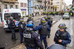 Police officers securing the zone in front of Yellow Jackets Gil. STRASBOURG, FRANCE - DEC 8, 2018: Police officers securing the zone in front of the Yellow stock images