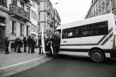 Police officers securing the zone in front of Yellow Jackets Gil. STRASBOURG, FRANCE - DEC 8, 2018: Police officers securing the zone in front of the Yellow royalty free stock photo