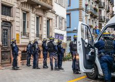 Police officers securing the zone in front of Yellow Jackets Gil. STRASBOURG, FRANCE - DEC 8, 2018: Rear view of police officers securing the zone in front of stock photo