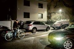 Silhouette of senior man cycling riding bike on snowy blizzard n Stock Photos
