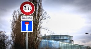 Road signs prohibiting access to vehicles over 3.5 tons and a dead end. Strasbourg, France - December 28, 2017 - next to the european parliament road signs royalty free stock photos