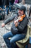 Portrait of smiling violinist playing in the street Stock Images