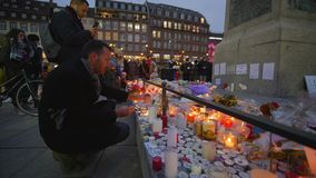 Tragic events, Grief compassion and tears of people in Consequences terrorist attack of on place of death with lots of