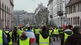 People Gilets Jaunes or Yellow Vest protest thousands of people