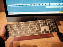 Man holding iMac Pro keyboard stock photography