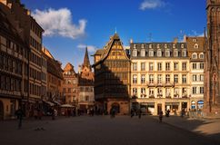 STRASBOURG, FRANCE - JANUARY 5, 2017: Cathedral Square in old sity. View of traditional half - timbered house Kammerzell - most fa Royalty Free Stock Images