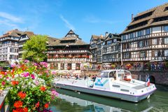 STRASBOURG, FRANCE - JUL 18, 2017: Traditional colorful houses in La Petite, with tourists taking a boat ride along traditional co. Lorful houses on idyllic Royalty Free Stock Images