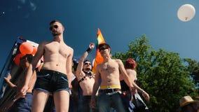 Gay pride in slow motion dancing LGBT people on truck