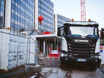 Cement mixer truck Scania. STRASBOURG, FRANCE - MAR 5, 2018: Front view of Scania G410 cement mixer truck at the reconstruction site of European Parliament and royalty free stock photos
